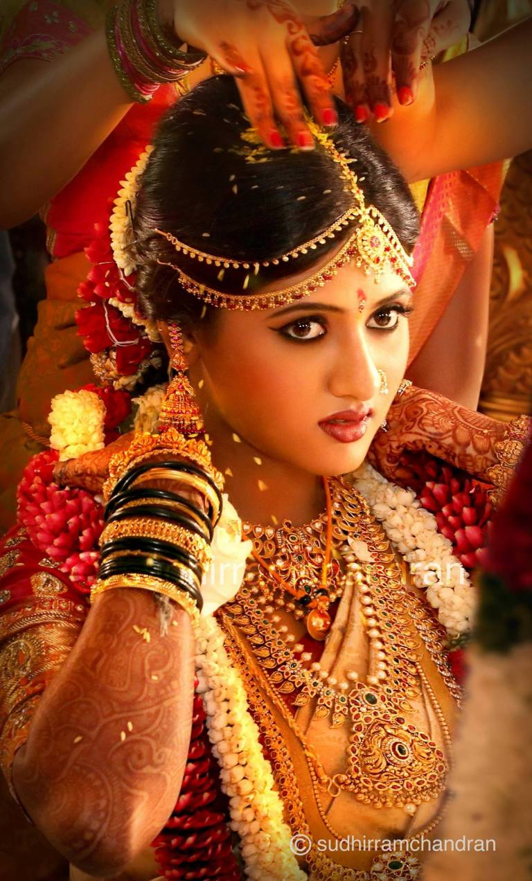 Strength in beauty,, Indian bride's portrait by wedding photographer Sudhir Ramchandran